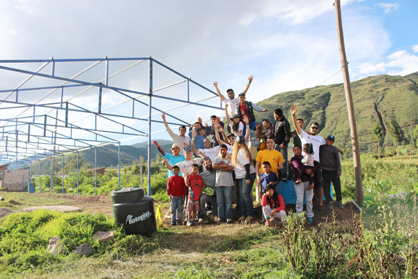 GlobalResolve students celebrate the completion of a new aquaponics system alongside children and caretakers from the Azul Wasi orphanage in Oropesa, Peru.