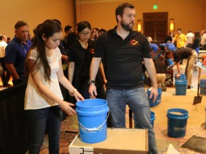 ASU students Devinne Ramirez (left) and John Furniss built a small-scale mechanically stabilized earth wall for a student competition at a recent major industry conference. Ramirez is undergraduate construction engineering major. Furniss is a graduate student in geotechnical engineering.