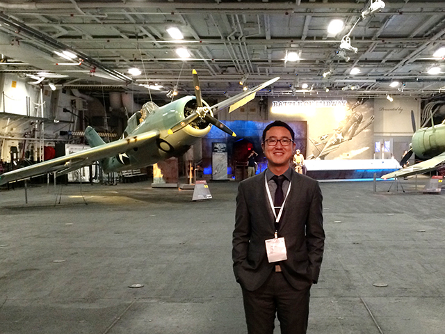 ASU mechanical engineering doctoral student Andrey Gunawan stands inside the aircraft hangar of the USS Midway Museum in San Diego, California, where he and lab partner Nicholas Fette were awarded the best student research paper award at the recent American Society of Mechanical Engineers national conference.