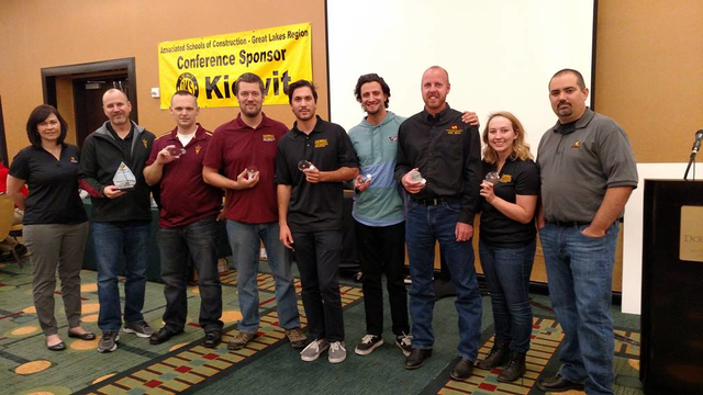 Flanked by Aldridge Electric contracting company employees who helped judge the construction management student competition are members of the prize-winning ASU team (from left to right): ASU lecturer Aaron Cohen, the team's coach, along with Steven Crofoot, Sean Osborne, Brandon Propp, Alexei Burtscher, Caleb Heinold, and Taylor Mount.