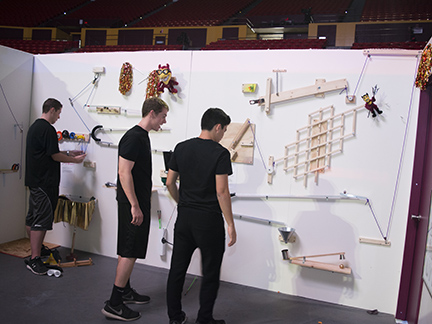 Members of ASU's 942 Crew, a Sun Devil Athletics Booster Club, team up to face the Rube Goldberg-style Escape Challenge Room during Emerge 2016. From left: Alex Linse, Kyle Bathe and Joey Palomarez. Photographer: Mihir Bhatt/ASU