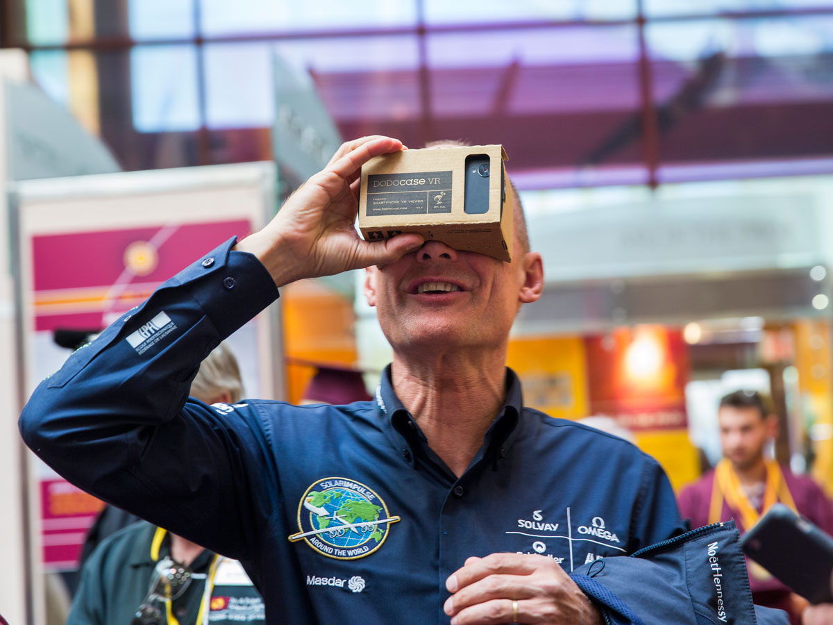 Bertrand Piccard tries out the Solar Impulse Cockpit VR Google Cardboard app prior to the spring 2016 Maroon Convocation Ceremony on May 11, 2016.