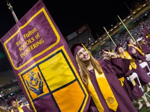 A Fulton Schools student holds a banner at the ASU Commencement ceremony