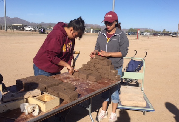 Earlier in 2016, a practicum student, a research assistant and a number of volunteers completed a housing design and materials study for the Gila River Indian Community. The focus was on investigating adobe block, the tribe's traditional building material. The students conducted a hands-on adobe-making demonstration at a community fair. Photo courtesy of Wanda Dalla Costa