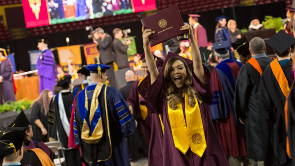 This photo shows a Fulton Schools grad celebrating at Convocation