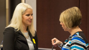 Two people talk at a career fair