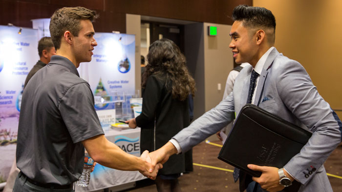 A recruiter and student shake hands