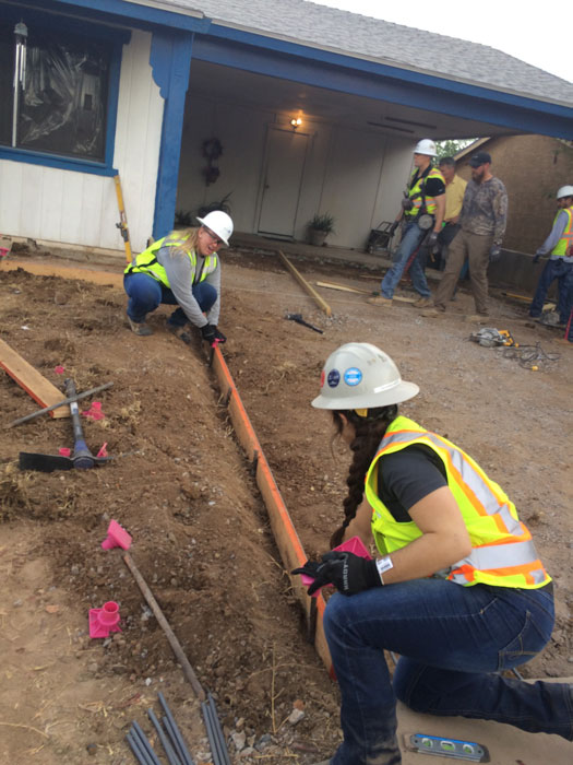 Students get an area ready to lay concrete.