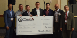 WearRAcon 17 Innovation Challenge contest winners pose with a giant check.
