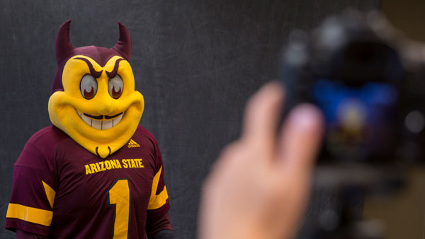 Sparky gets his photo taken.