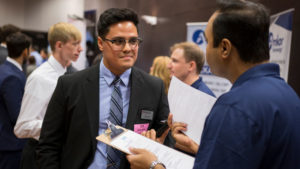 A student talks to a recruiter at Career Fair.