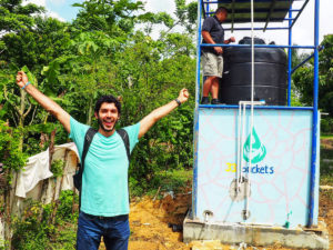 Mark Huerta of ASU startup 33 Buckets celebrates his team's work in the Dominican Republic.