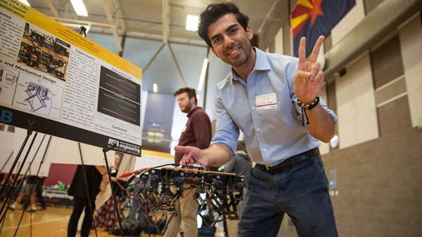A student shows off a prototype at Innovation Showcase