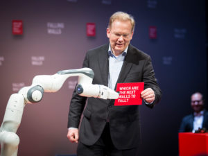 Man receiving red card from robot arm