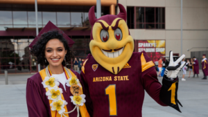 Sparky poses with a grad
