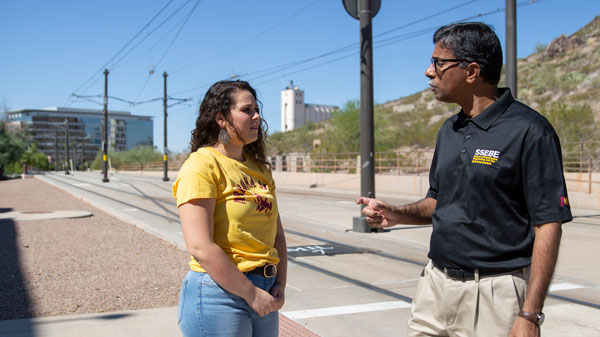 FURI student Amanda Minutello talks with her mentor at a Tempe light rail station.