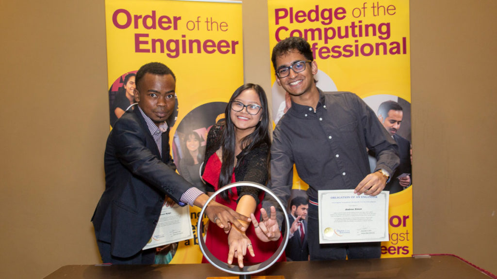 Graduating students participating in Order of the Engineer.