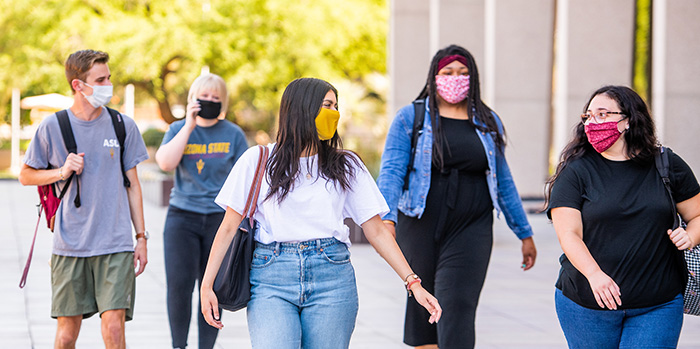 Students on campus wearing face masks.
